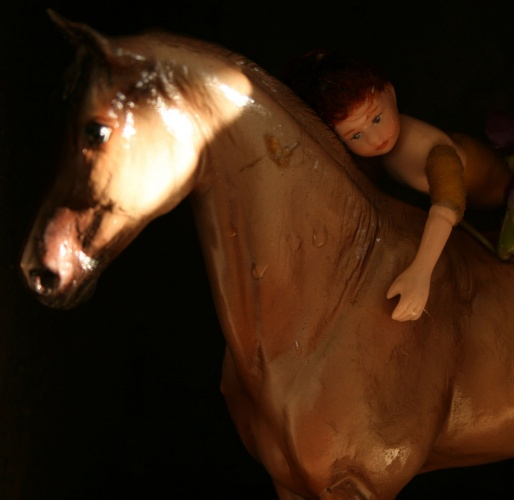 Surreal photo of a doll on a horse