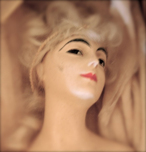 Surreal photo of a doll\'s head
