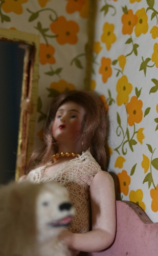 Surreal photo of a doll in interior scene