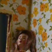 Surreal photo of a doll in interior scene