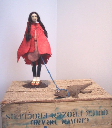 Sculpture of girl with alligator pet by Laurel Hausler